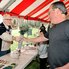 John P. Cleary | The Herald Bulletin  <br /> Volunteer Blake Janutolo gives Allan Ward two White Pine seedlings during <br /> ArborFest celebration activities Saturday.