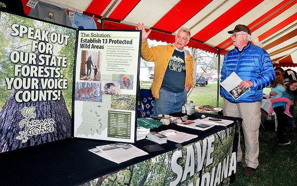 John P. Cleary | The Herald Bulletin  <br /> Jeff Stant, of the Indiana Forest Alliance, talks with Joe Carney about their cause during the City of Anderson ArborFest celebration Saturday at Shadyside Park.