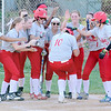 Don Knight | The Herald Bulletin<br /> Anderson's Kalin Hubble is greeted by her teammates after hitting a two-run home run against Liberty Christian on Friday.