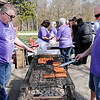Don Knight | The Herald Bulletin<br /> From left, John Wendt and Mark Burkhardt grill hotdogs as Dove Harbor held a block party to celebrate their 25th Anniversary at Madison Park Church of God's North Campus on Thursday.