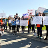 John P. Cleary | The Herald Bulletin  <br /> As the bagpipes were played, several hundred Anderson High School students joined the national walkout for change in school safety Friday morning holding signs and rallying in front of the school.