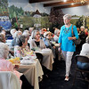 John P. Cleary | The Herald Bulletin  <br /> Lora Mueller walks through the crowd as she models this outfit during the <br /> Isabel Society of United Faith Housing Spring Luncheon and Style Show Wednesday at the Harter House. Fashions this year were from The Victoria Guild at St. Vincent Anderson and Stein Mart.