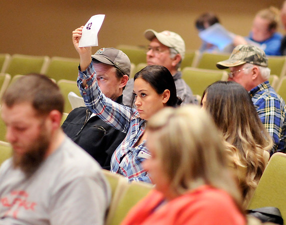 John P. Cleary | The Herald Bulletin  <br /> Bidders showed up for the Madison County tax sale Monday, at the Anderson City Building auditorium, where hundreds of properties went up on the auction block for delinquent taxes.