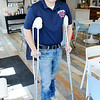 Don Knight | The Herald Bulletin<br /> Hunter Barger said the only reason why he's on crutches instead of in the hospital or worse is because he was wearing a helmet.