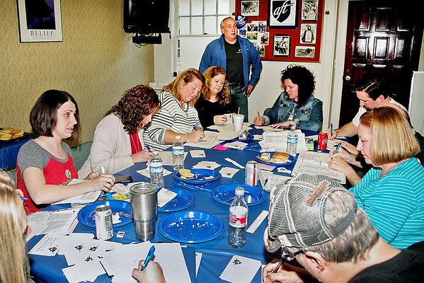 Mark Maynard   for The Herald Bulletin<br /> AFT volunteers Michelle Lusher, Holly Plough, Thonja Nicholson, Stacie Partezana, Marisa Graham, David Plough, Bill Malone, Carlynn Malone and Patrick Hill address postcards for a mass-mailing as Union President Randy Harrison looks on.