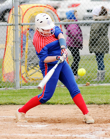 Don Knight | The Herald Bulletin<br /> Elwood's Madison Tincher connects for a double as the Elwood Panthers hosted the Jay County Patriots on Friday.