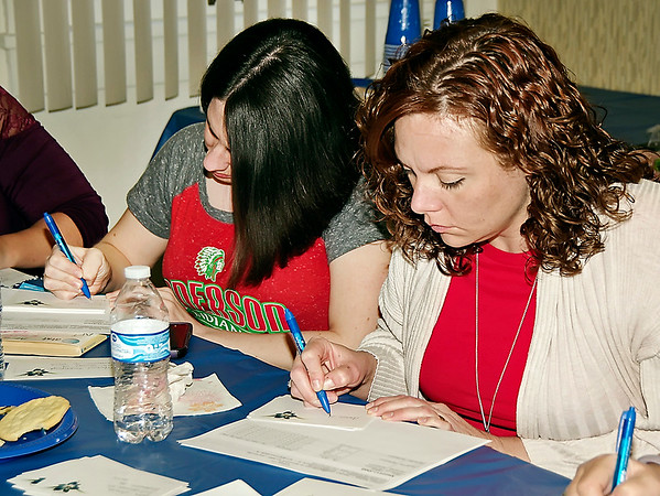 Mark Maynard | for The Herald Bulletin<br /> At the Anderson Federation of Teachers office, Michelle Lusher and Holly Plough concentrate on the task of addressing postcards urging support for the ACS bond referendum.