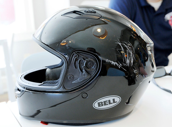 Don Knight | The Herald Bulletin<br /> Hunter Barger's helmet took the hits his head would of if he had not been wearing during a motorcycle accident earlier this month.