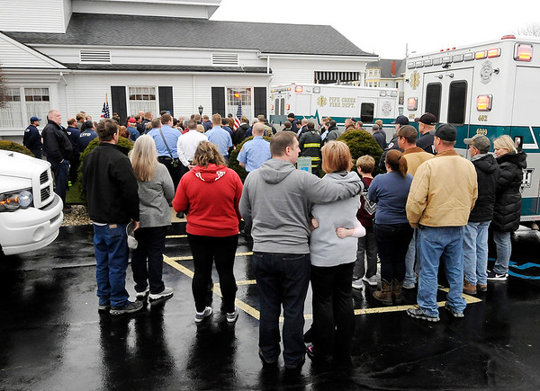 Don Knight | The Herald Bulletin<br /> The procession for Pipe Creek firefighters Kyle Hibst and David Wittkamper ends with a prayer at Copher-Fesler-May Funeral Home in Elwood on Tuesday.