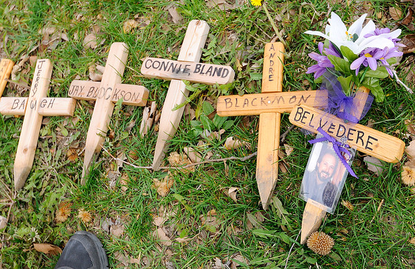 Don Knight | The Herald Bulletin<br /> Wooden crosses are unpacked and organized for installation at Citizen's Plaza Park on Friday. Over 300 crosses will be placed in memory of victims of homicide or death by impaired drivers.