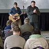 Ryan Dick, Key Worship Leader, accompanies Pastor Jaime Woodyard as he leads the members of the Harvest Bible Chapel, Anderson Campus, in prayer on Palm Sunday.
