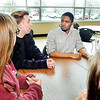 John P. Cleary | The Herald Bulletin  <br /> Anderson High School junior Noah Green, second from left, discusses plans with fellow student, Damarion Page and others, about the upcoming student walkout scheduled for April 20th at the school.