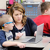 Don Knight | The Herald Bulletin<br /> Meghan Hersberger helps Finnley Toney log onto an online quiz at Frankton Elementary School on Friday.