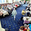 John P. Cleary | The Herald Bulletin  <br /> The Isabel Society of United Faith Housing held their Spring Luncheon and Style Show Wednesday at the Harter House. Here model Sharon Dotson shows off her rain cape outfit to those in attendance at the annual event.