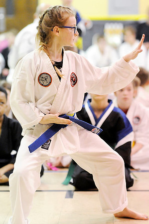 Don Knight | The Herald Bulletin<br /> Baleigh Combs, a student at Foreman's Karate & Fitness, wins first place in kata for her age group  during a tournament at Edgewood Elementary on Saturday.