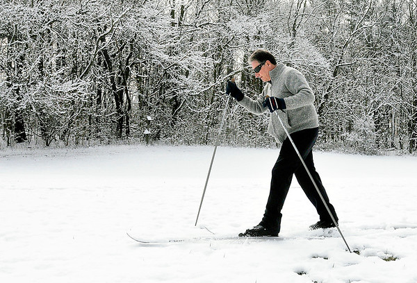 John P. Cleary   The Herald Bulletin<br /> Mike Sheffield, of Muncie, takes advantage of the Easter snowfall as he glides through Mounds State Park Monday morning on his skies taking in the snow covered landscape.