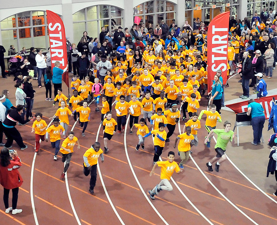 John P. Cleary   The Herald Bulletin   THB file photo<br /> Several hundred kids start the last mile of the St. Vincent-YMCA Kidz Marathon  together at Kardatzke Wellness Center Saturday morning.  The annual event  helps to promote health and fitness in children.