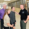 John P. Cleary | The Herald Bulletin  <br /> Alexandria Jr.-Sr. High School has Alexandria Police officer Matt Blakely assigned to the school for extra security for the remainder of the school year.<br /> Here officer Matt Blakely, right, talks with assistant principal, and school safety supervisor, Dean Morehead, along with senior students Mary Sayre and Ryan Luzadder in the hallway of the school.