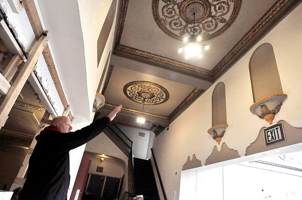 John P. Cleary   The Herald Bulletin  <br /> Brent Doster, co-owner of MadCo Entertainment, LLC., points out some of the detail work they want to keep as they work to renovate the State Theatre.