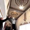 John P. Cleary | The Herald Bulletin  <br /> Brent Doster, co-owner of MadCo Entertainment, LLC., points out some of the detail work they want to keep as they work to renovate the State Theatre.