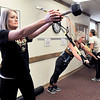 John P. Cleary | The Herald Bulletin<br /> St. Vincent Anderson fitness class for employees that is part of their WellnessWork program. Here Stacy Harmon, executive assistant to VP of Operation; Carole Edwards, RN, BSN, MA, Emergency Service Education, and Chloe Miller, clinical dietician each do the exercise that their station calls for. There are 11 stations total.