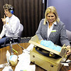 Don Knight | The Herald Bulletin<br /> Joyce Gaskill responds as Connect Hearing Doctor of Audiology Debbie Lekarczyk tests her hearing during the Madison County Community Connect Event at the Impact Center on Wednesday. The event gathered together organizations from across the community.
