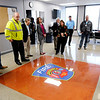 Don Knight | The Herald Bulletin<br /> Assistant Chief Todd Cawthorn talks about a epoxy floor painting given by Indiana Flooring to the Anderson Fire Department as part of their Fire Station Headquarters remodel. AFD held an open house and ribbon cutting to mark the completion of phases one and two of renovations downtown on Wednesday. Phase three will include painting and repairs to the exterior of the building. The project cost $1.1 million and was paid for through collections of outstanding bills owed the department.