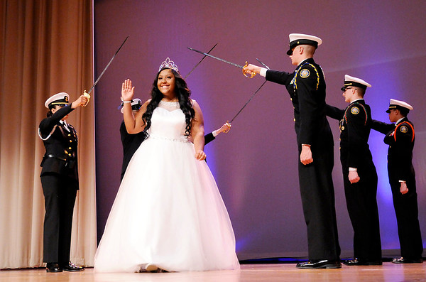 Don Knight   The Herald Bulletin<br /> Destinee Malone waves as she is introduced during the Debutante Cotillion/Beautillion Militaire Program at Reardon Auditorium on Saturday.