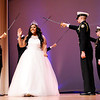 Don Knight | The Herald Bulletin<br /> Destinee Malone waves as she is introduced during the Debutante Cotillion/Beautillion Militaire Program at Reardon Auditorium on Saturday.