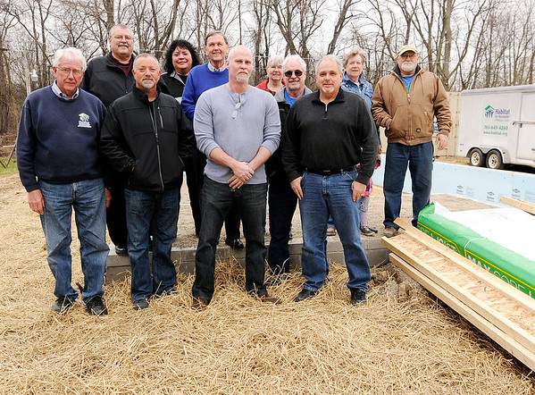 Don Knight | The Herald Bulletin<br /> Chesterfield donated property for the community's first Habitat for Humanity house. Front row from left are Carl Caldwell, Scott Hardin, Lee Throneburg and Ed Leonard. Second row from left are Jack Taylor Deborah Dunham, Buddy Patterson, Kelly Dossett, Steve McMullen, Carol Cates and Don Swenk.