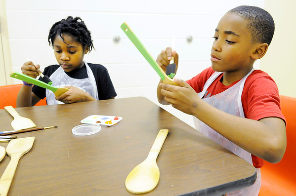 Don Knight | The Herald Bulletin From left, Alaiyha Campbell and Drayden White paint spoons that will be used as plant markers at the Impact Center on Saturday.