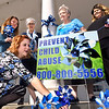 John P. Cleary | The Herald Bulletin <br /> Stephanie Fertucci, director of the Children's Bureau, plants a pinwheel as Carrie Frauhiger, Children's Bureau intern; Gloria Dunaway-Harlett, Anderson Noon Exchange Club; Bonny Clark, Anderson Noon Exchange Club program coordinator; and Hannah Burke, Children's Bureau assistant director, look on waiting with more pinwheels. This was part of the kickoff luncheon for National Child Abuse Prevention Month Tuesday at the Edgewood Golf Course and Event Center.