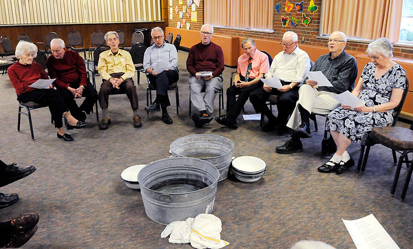 Don Knight | The Herald Bulletin Park Place Church of God congregants sing hymns after washing each others feet during their Maundy Thursday service.
