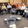 Don Knight | The Herald Bulletin<br /> Park Place Church of God congregants sing hymns after washing each others feet during their Maundy Thursday service.