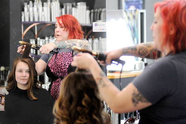 Don Knight | The Herald Bulletin<br /> Sharon Zimmer styles Jordyn Friend's hair for Lapel's prom at Medusa Hair Salon on Saturday.