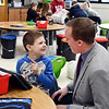 John P. Cleary | The Herald Bulletin <br /> Elwood Elementary School kindergartener Nathan Lemar smiles as he talks with Elwood Community Schools superintendent Joe Brown while he stopped by  classroom during a visit to the school recently.