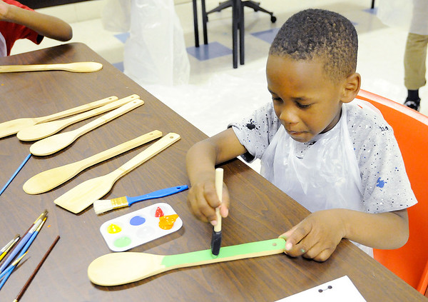 Don Knight | The Herald Bulletin Azai White, 6, paints a spoon that will be used as a garden marker at the Impact Center on Tuesday. The Sweet 16 garden group was preparing for the growing season.
