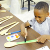 Don Knight | The Herald Bulletin<br /> Azai White, 6, paints a spoon that will be used as a garden marker at the Impact Center on Tuesday. The Sweet 16 garden group was preparing for the growing season.