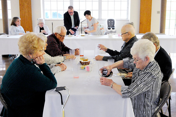 Don Knight | The Herald Bulletin The elements of communion are served after a meal during the Maundy Thursday service at Park Place Church of God.