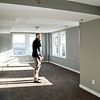 John P. Cleary | The Herald Bulletin <br /> Gavin Railing, of Core Redevelopment, checks the view from the master bedroom of this two-bedroom apartment nearing completion in the rehabilitated Tower Apartment Building Thursday.