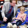 John P. Cleary | The Herald Bulletin <br /> Elwood Community Schools superintendent Joe Brown talks with Elwood Elementary School kindergartener Maci Faucett as she reads her book.