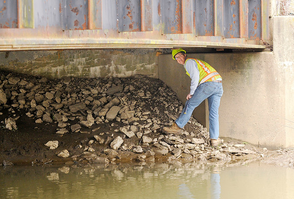 Don Knight | The Herald Bulletin<br /> Dan Mullaney with SJCA inspects the bridge on County Road 425 East over Killbuck Creek on Wednesday.