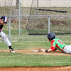 Chris Martin | For The Herald Bulletin<br /> Anderson's Cameron Pratt steals 3rd Base on his way to scoring the first run for the Indians.  Anderson hosted Eastern (MI) Saturday at Memorial Field