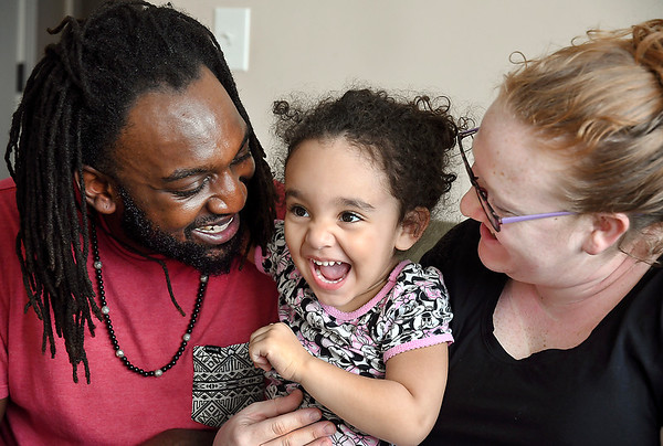 John P. Cleary | The Herald Bulletin <br /> Tylis Larkin and his wife Megan have fun playing with their daughter Amara, 2.