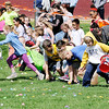 Don Knight | The Herald Bulletin<br /> Kids race to pick up candy-filled Easter Eggs during Daybreak Community Church's Easter Egg Hunt in Lapel on Saturday. The church spread over 18,000 eggs on their lawn for the event.