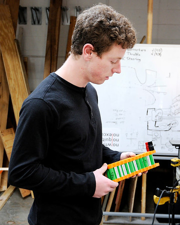 Don Knight   The Herald Bulletin<br /> Anderson University student Tom Sheahan talks about a battery pack he designed. The engineering department is hosting an open house on Monday.