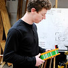 Don Knight | The Herald Bulletin<br /> Anderson University student Tom Sheahan talks about a battery pack he designed. The engineering department is hosting an open house on Monday.