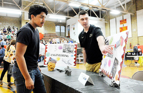 Don Knight   The Herald Bulletin Brant Dotson, a process engineer for Mancor, talks to Juan Cabello about career opportunities in engineering during a career fair at Liberty Christian on Wednesday.