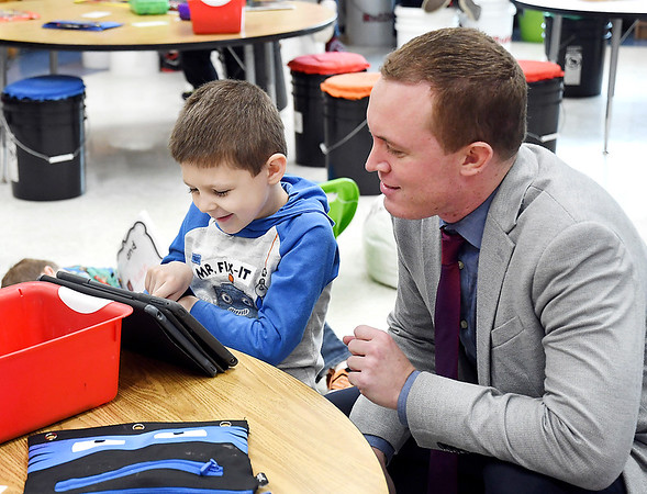 John P. Cleary | The Herald Bulletin <br /> Elwood Elementary School kindergartener Nathan Lemar reads to Elwood Community Schools superintendent Joe Brown while he stopped by  classroom during a visit to the school recently.