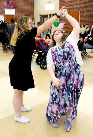 Don Knight | The Herald Bulletin<br /> Ravynn Schroeder twirls Jacey Davis while dancing during Anderson High School's 10th annual special needs prom in the cafeteria on Thursday.